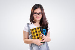 Retrato nerdy adorable de la muchacha en blanco Imagen de archivo