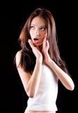 Retrato novo da mulher querendo saber Foto de Stock