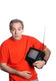 Retrato ocasional del hombre con un aparato de TV Imagen de archivo