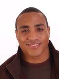 Retrato sonriente joven del hombre negro en chaqueta Imágenes de archivo libres de regalías