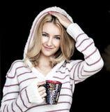 Retrato suave del adolescente que bebe el café caliente en casa Foto de archivo libre de regalías
