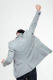 Retrato traseiro da vista de um homem de negócios que comemora seu sucesso Imagem de Stock Royalty Free