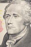 Retrato vertical de la cara del ` s de Alexander Hamilton en el billete de dólar de los E.E.U.U. 10 Tiro macro Imagen de archivo