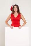 Retrato vertical de la muchacha de la Navidad con la copa en el fondo blanco Imagen de archivo