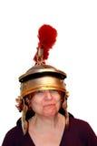 Retratos divertidos - mujer con el casco romano Foto de archivo libre de regalías