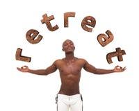 Retreat. Young muscular man meditating. Stock Image