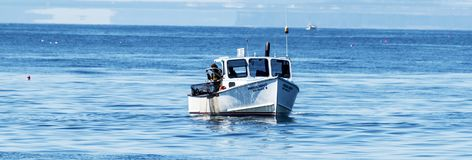 Retreiving lobster traps fro the ocean in Maine Royalty Free Stock Photo