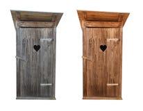 Retretes de madera aislados en blanco Imágenes de archivo libres de regalías