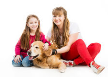 Retriever and girls Royalty Free Stock Photography