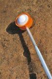 Retrieving a Golf Ball from a Water Hazard Stock Photo