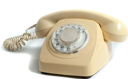 Retro żółty telefon odizolowywający na białym tle Fotografia Stock