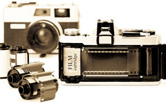 Retro 35mm camera with film opened back side. Retro 35mm camera with film opened back side on white background Stock Image