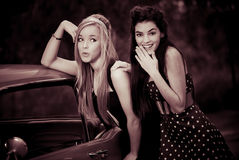 Retro 60s teens. Retro vintage teens 60s or sixties girls with car royalty free stock photography