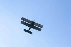 Retro aeroplane  in the blue sky Stock Photos