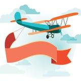 Retro aeroplano con una bandiera Immagine Stock