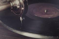 Retro ago d'annata su un grammofono record Fotografia Stock