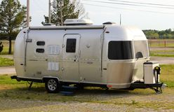 Retro Air Stream Recreational Vehicle. Side View of an old retro Air Stream Recreational Vehicle (RV) in an mobile home parking lot Stock Photography