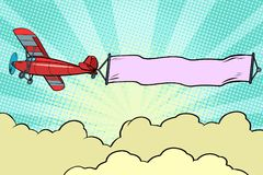 Retro airplane with a ribbon in the sky vector illustration