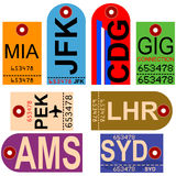 Retro airplane tags. Old style illustration showing retro looking airplane tags with different airport codes stock illustration