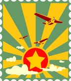 Retro airplanes flight on sun burst backdrop Royalty Free Stock Images