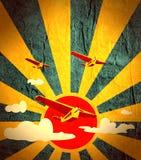 Retro airplanes flight on sun burst backdrop Stock Photography