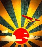 Retro airplanes flight on sun burst backdrop Stock Image