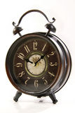 Retro alarm clock. On the white background Royalty Free Stock Images