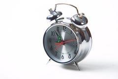 Retro alarm clock. Closeup of retro silver alarm clock isolated on white background royalty free stock image