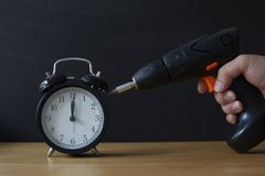 Free Retro Alarm Clock And Electric Driller. Stock Photos - 159892783