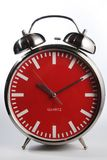 Retro alarm clock with bell. Old style red faced alarm clock with real alarm bells Royalty Free Stock Images