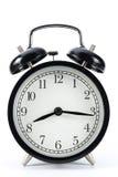 Retro alarm clock. Black metal retro alarm clock with isolated white background show 20:16 Royalty Free Stock Photos