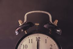 Retro alarm clock black with rust. royalty free stock image