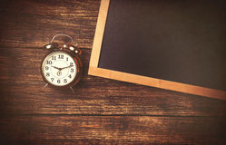 Retro alarm clock and blackboard Royalty Free Stock Images