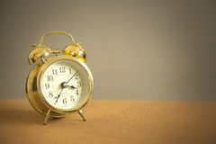 Retro alarm clock on board Stock Photo