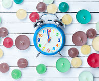 Retro alarm clock and candles Royalty Free Stock Photos