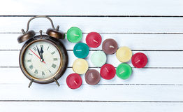 Retro alarm clock and candles Royalty Free Stock Photo