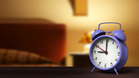 Retro alarm clock closeup. With bedroom in the background Royalty Free Stock Images