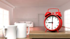 Retro alarm clock closeup with two cups of coffee Stock Images