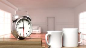 Retro alarm clock closeup with two cups of coffee. And house interior in the background Stock Image