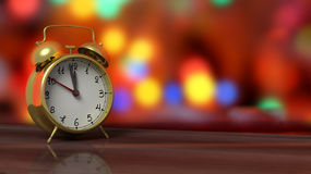 Retro alarm clock closeup on wooden tabletop. With colorful bokeh background Stock Photos