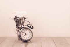 Retro alarm clock and  flowers Royalty Free Stock Photos