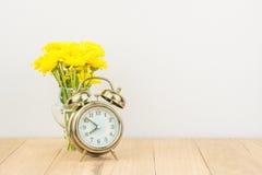 Retro alarm clock and  flowers Royalty Free Stock Image