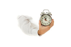 Retro alarm clock, hand. Royalty Free Stock Images