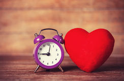 Retro alarm clock and heart shape Stock Image