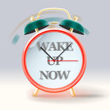 Retro alarm clock, with inscription Wake up now Stock Image