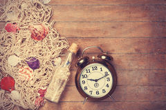 Retro alarm clock and net Royalty Free Stock Photography