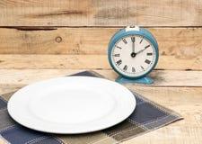 Retro Alarm Clock On A Plate Stock Photos
