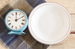 Retro Alarm Clock On A Plate Royalty Free Stock Images
