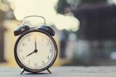 Retro Alarm Clock On Wooden Table Stock Image
