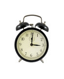 Retro alarm clock showing three hours Royalty Free Stock Images
